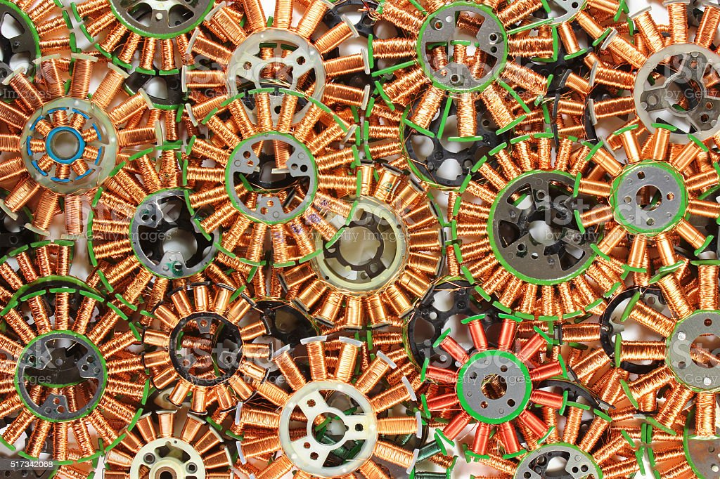 Parts of disassembled brushless dc electric motors. Colorful tec stock photo