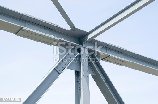 Parts of gray steel construction of a bridge in sunny day