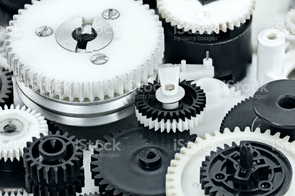 parts of industrial mechanisms. plastic black and white cogwheels. royalty-free stock photo