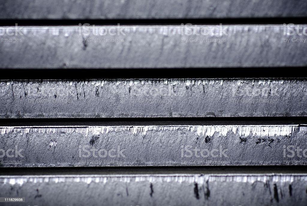 Parts of some metal object with some scratches stock photo