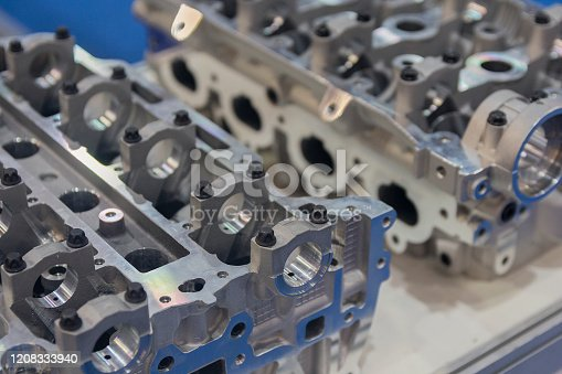 936360074 istock photo Parts of the automobile engine on a table. Industry 1208333940