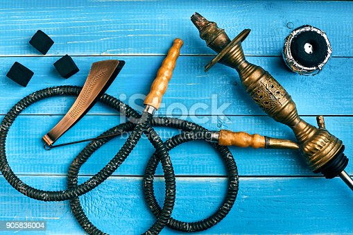 istock Parts of the hookah on blue wooden background. Hookah accessorie 905836004