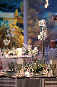 table, plates, glasses and flowers arranged in wedding party montage