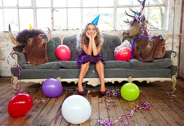 party-animals und schöne junge frau - shabby deko stock-fotos und bilder