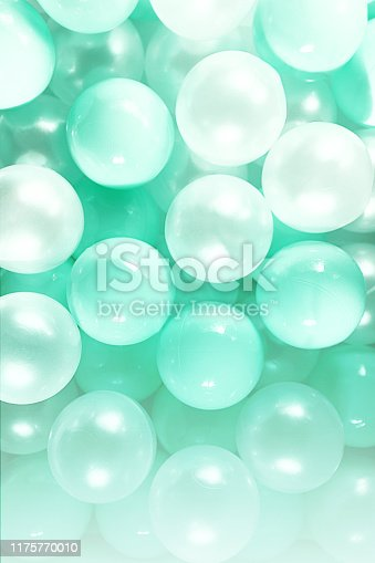 istock Party background made of mint green pastel color balls bubbles. 1175770010