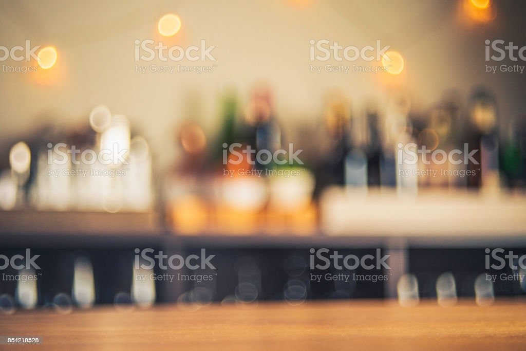Party background with defocused bottles and glasses stock photo