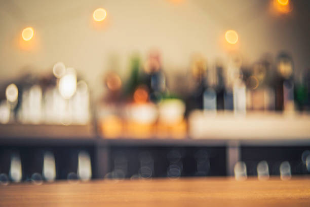 party background with defocused bottles and glasses - soft focus stock photos and pictures