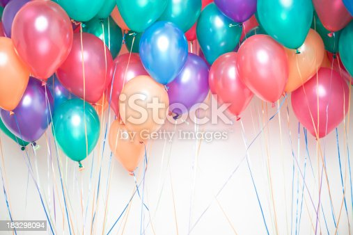 group of colorful helium party balloons