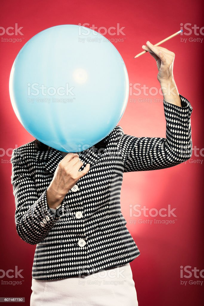Party baloon about to be punctured stock photo