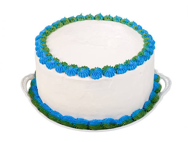 Party cake to personalize Homemade birthday or party cake frosted with white icing and decorated with blue and green details. The top of the cake is plain white so you can personalize it. buttercream stock pictures, royalty-free photos & images