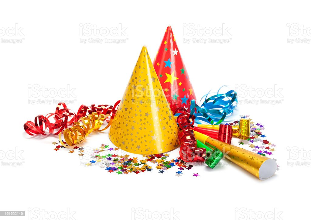 Party caps, confetti and streamers stock photo