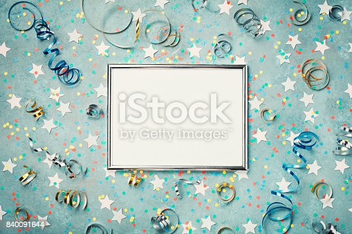 istock Party, carnival, christmas or birthday background decorated silver frame with colorful confetti. Holiday mockup. Greeting card with copy space. 840091644
