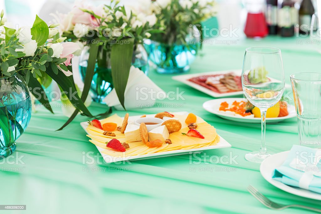 Party cheese board on a table royalty-free stock photo