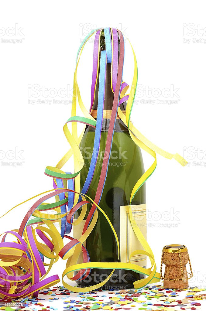 Party decoration with champagne bottle, cork and paper streamer, confetti royalty-free stock photo
