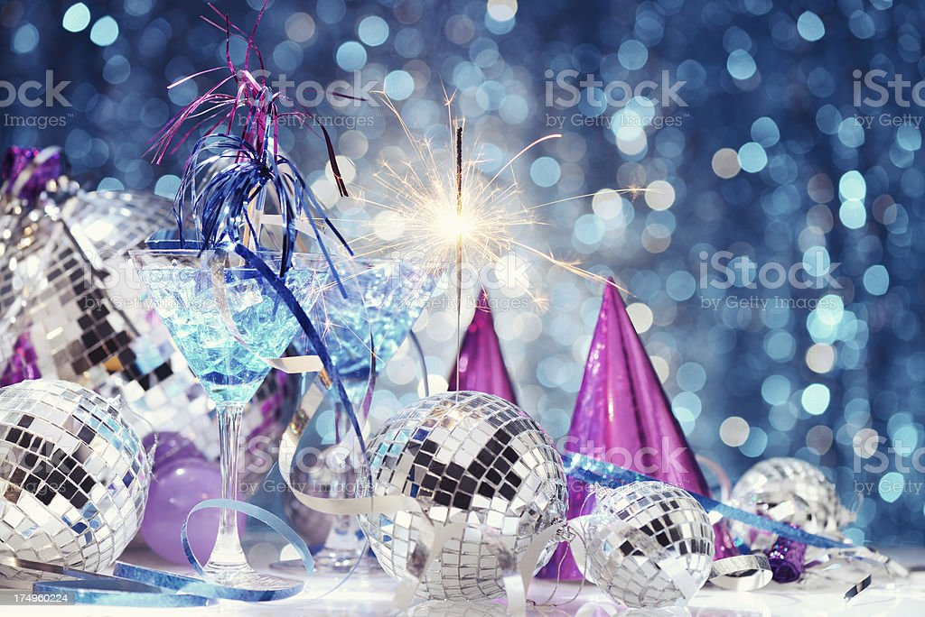 Party decoration with disco balls and fire sparkler royalty-free stock photo