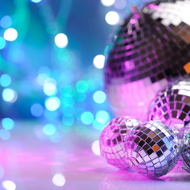 Party decoration with disco balls Party decoration with disco balls lit with colored bare flashes prom night stock pictures, royalty-free photos & images