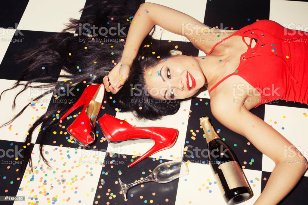 Party detail with woman high heels and bottle stock photo