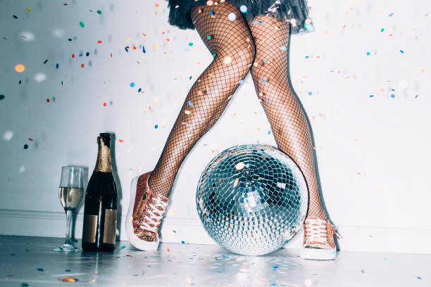 party details of female legs and disco ball - black women wearing pantyhose stock photos and pictures