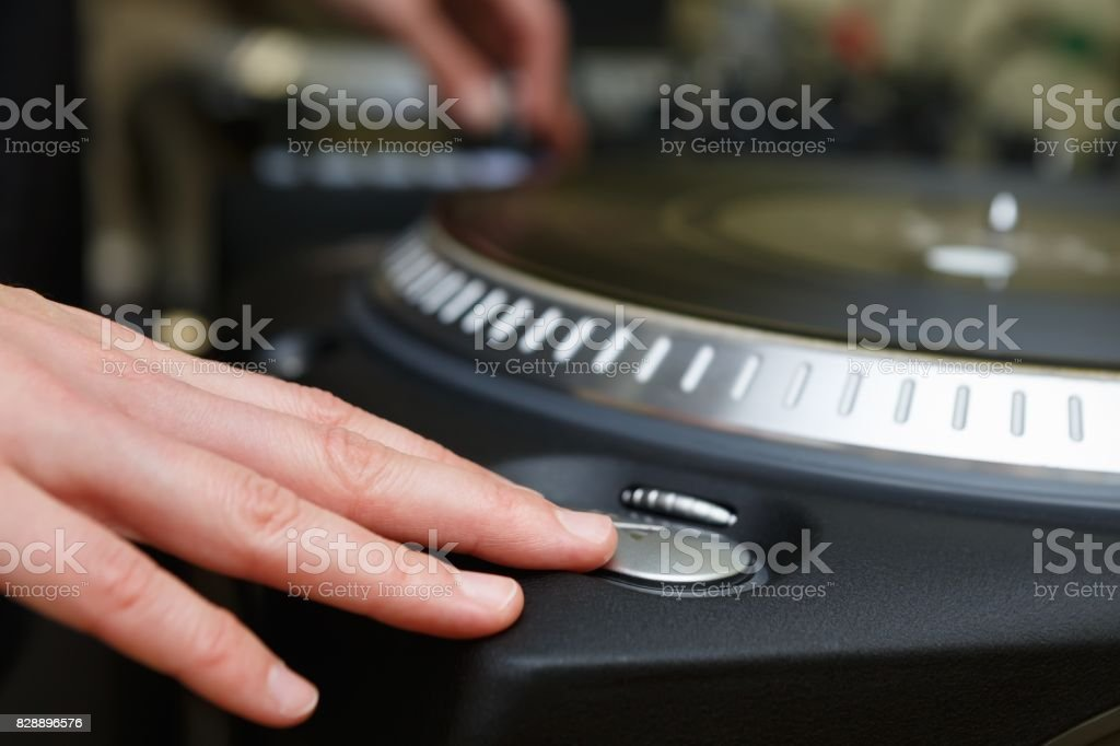 Party dj play music,scratch vinyl record on turntable stock photo