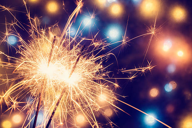 party feeling with sparklers - sparkler stock pictures, royalty-free photos & images