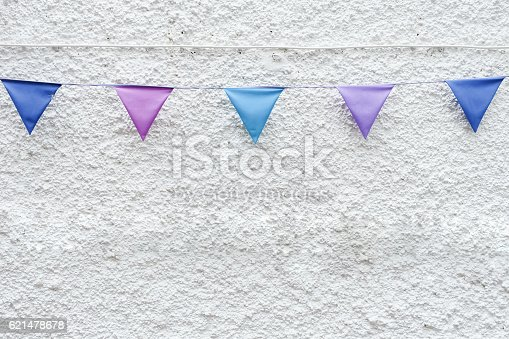istock Party flags bunting white wall background. Minimal hipster style design 621478678