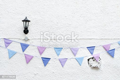 istock Party flags bunting white wall lamp. Minimal hipster style design 621478536