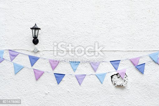 istock Party flags bunting white wall lamp. Minimal hipster style design 621478560