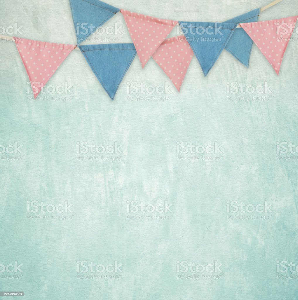 Party flags hanging on green cement wall background, decorate items for festival, celebrate event royalty-free stock photo