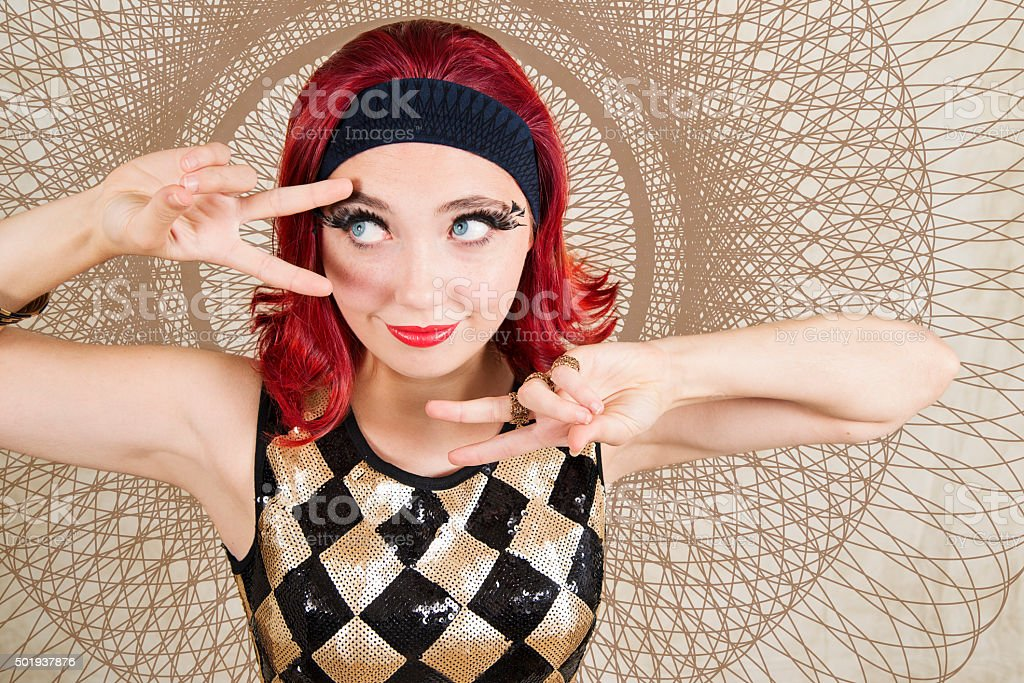 Party girl red hair and sequin dress rocking the sixties. stock photo