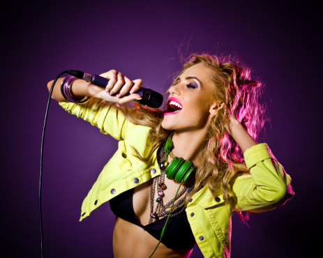 149411010 istock photo Party Girl singing 155350236