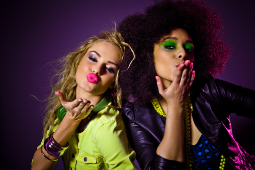 149411010 istock photo Party Girls blowing kisses 155286722