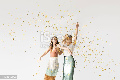 istock Party Girls Dancing Under Confetti 1178342903