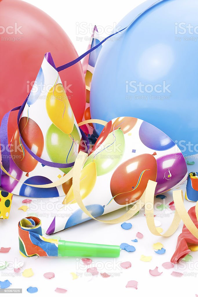 Party hats, noisemakers, confettis and balloons royalty-free stock photo
