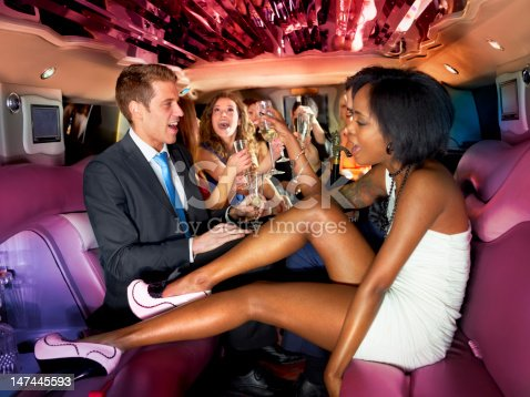 Group of young people partying in a limo
