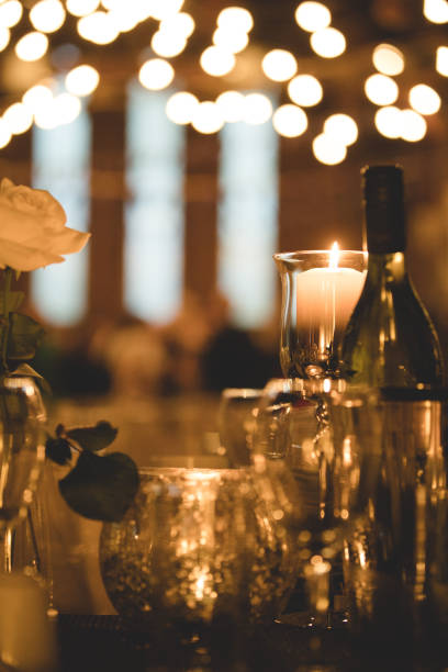 party in dimly lit restaurant - dimly stock pictures, royalty-free photos & images