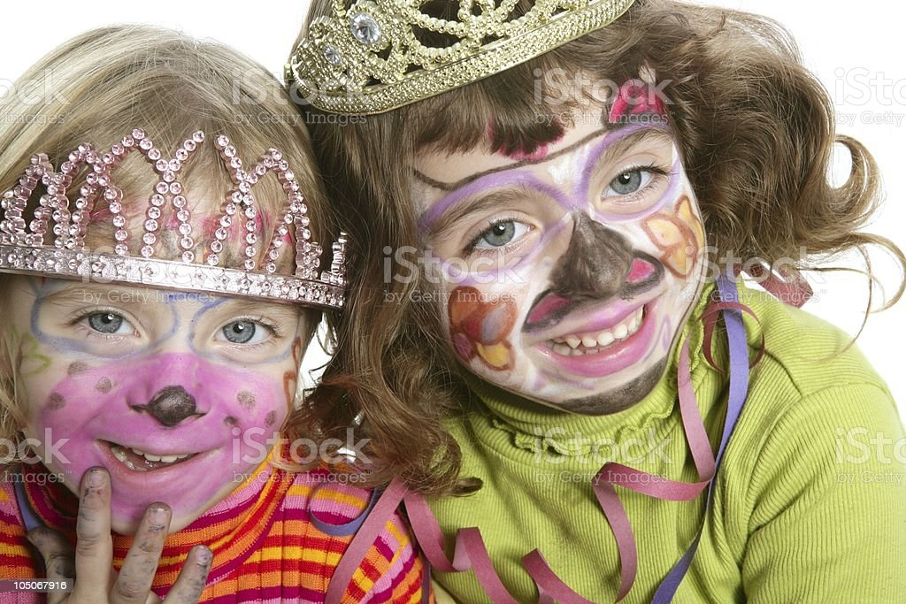 party little two sisters with painted happy face royalty-free stock photo