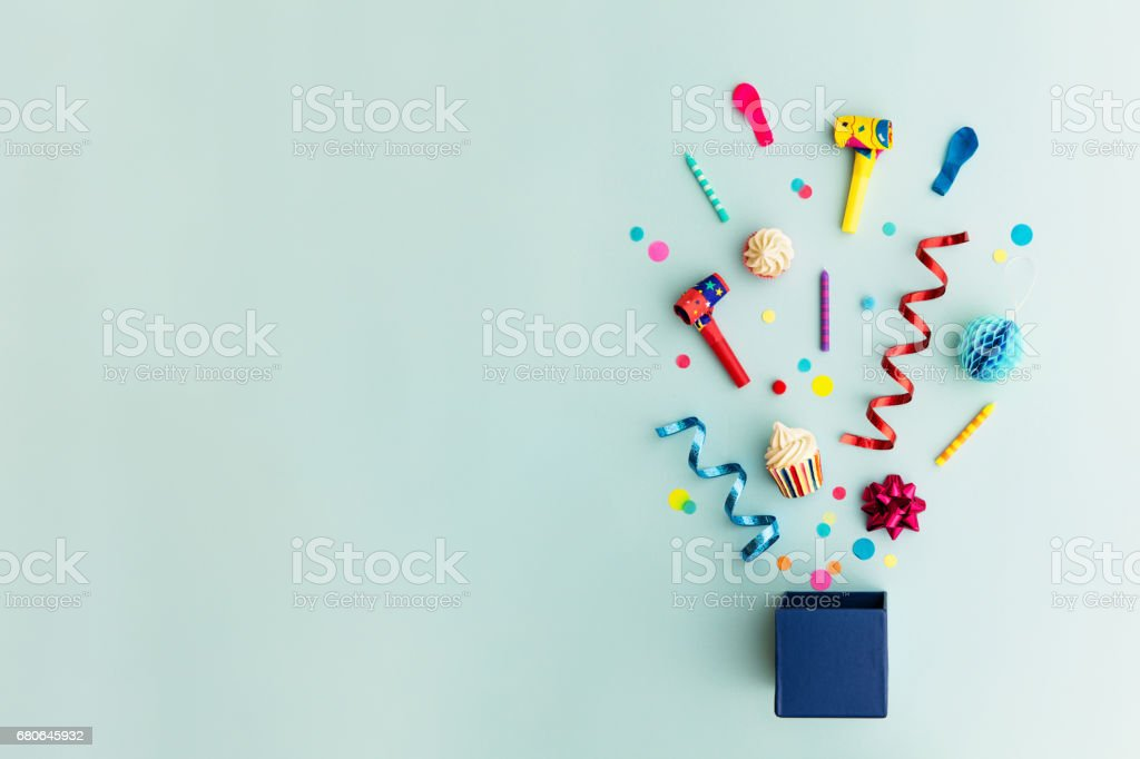 Party objects in a gift box stock photo