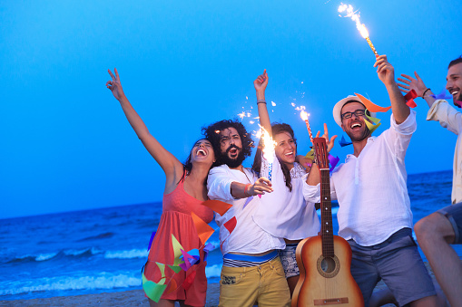 471113366 istock photo Party on the beach with fireworks 528895302