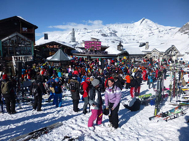 Party on the Slopes Val d'Isere, France - March 17, 2016: A busy bar on the slopes as people party in the sunshine apres ski stock pictures, royalty-free photos & images