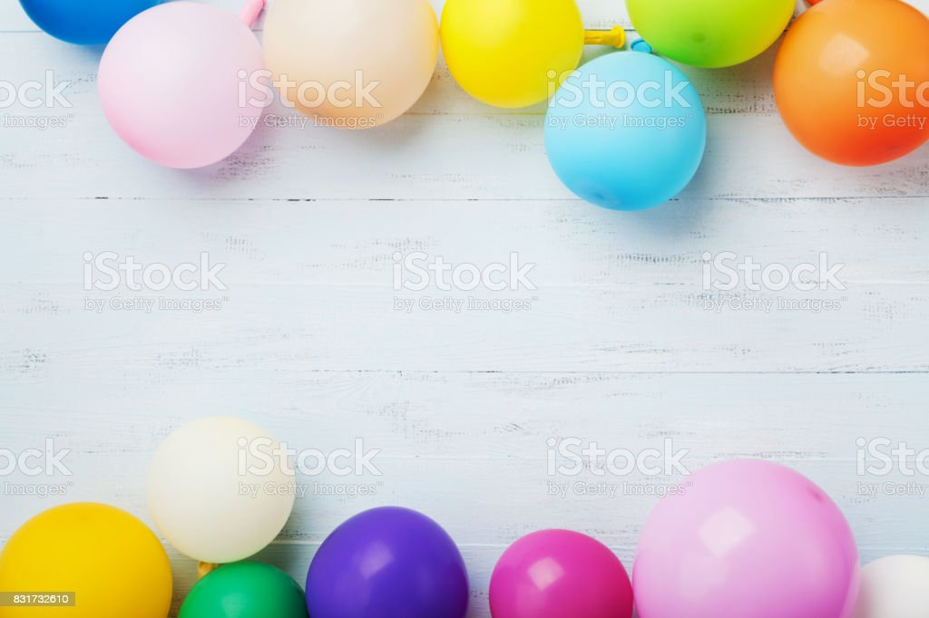 Party or birthday banner with colorful balloons on blue wooden background top view. Flat lay. stock photo