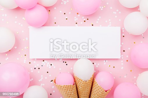 950793576 istock photo Party or birthday mockup with paper card, pastel balloons and confetti on pink table top view. Flat lay. 950793498
