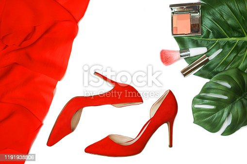 1078252326 istock photo party outfit red shoes, accessories makeup cosmetics, ropical monstera leaves on white background isolated. 1191938806