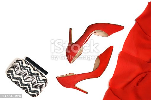 1078252566 istock photo Party outfit red shoes, accessories white and black fashion clutch on white background, isolated. 1177022526