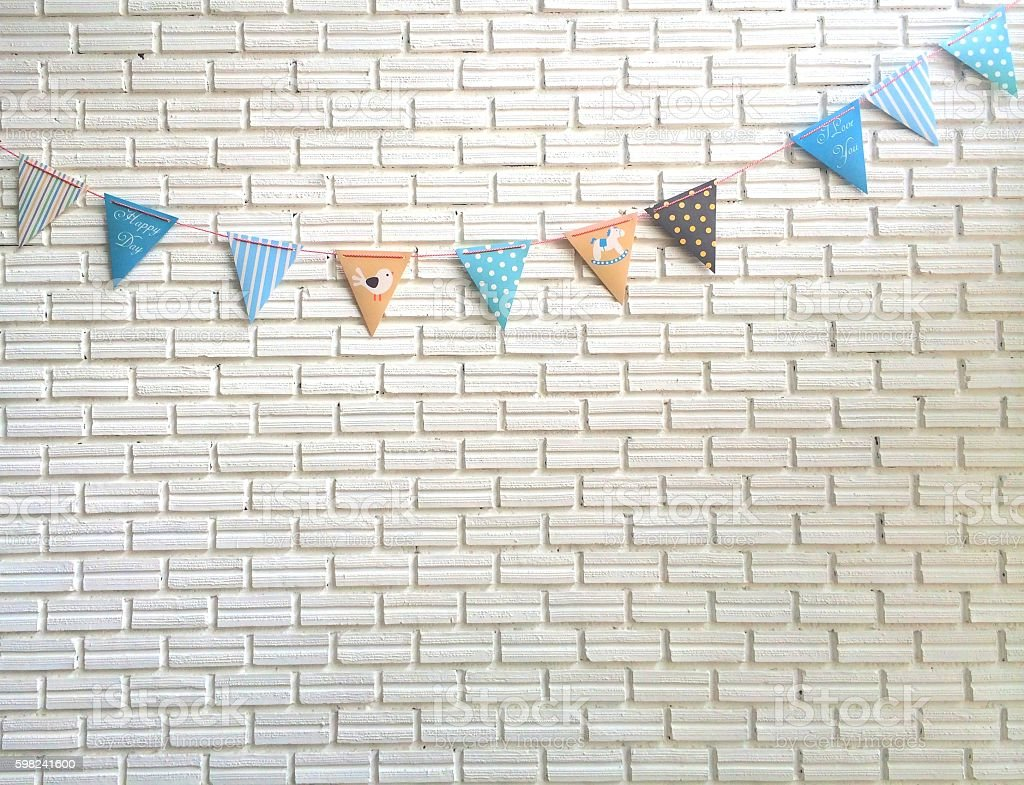 Party pastel flag strips on white brick block wall stock photo
