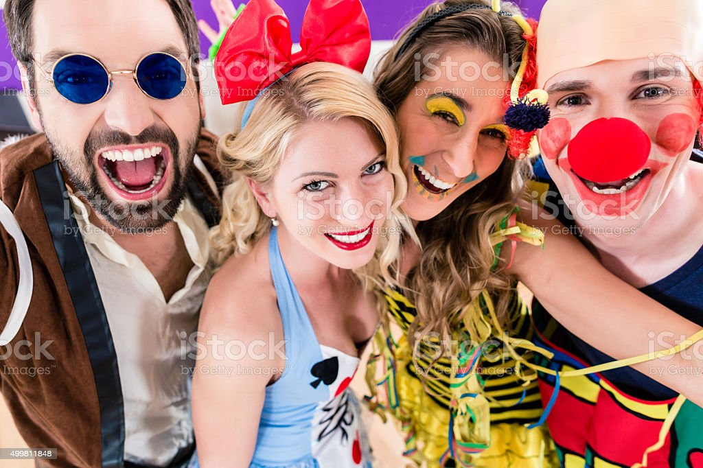 Party people celebrating carnival or new years eve stock photo