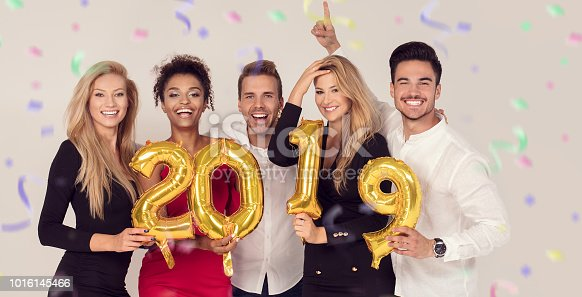 istock Party people celebrating new years eve. 1016145466