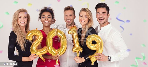 istock Party people celebrating new years eve. 1016146302
