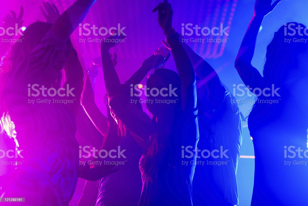 Party people dancing in disco club royalty-free stock photo