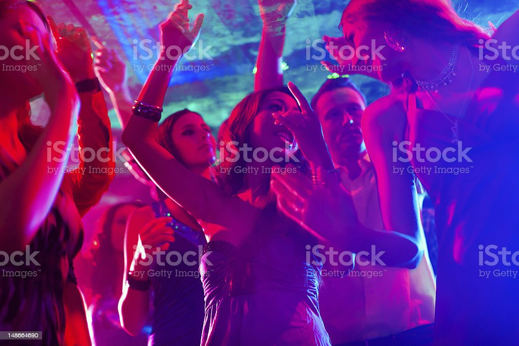 Party people dancing in disco or club stock photo