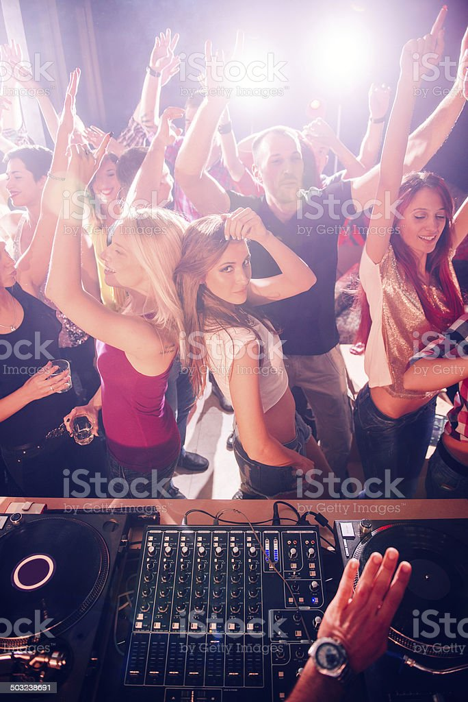 Party people in front of the DJ stock photo